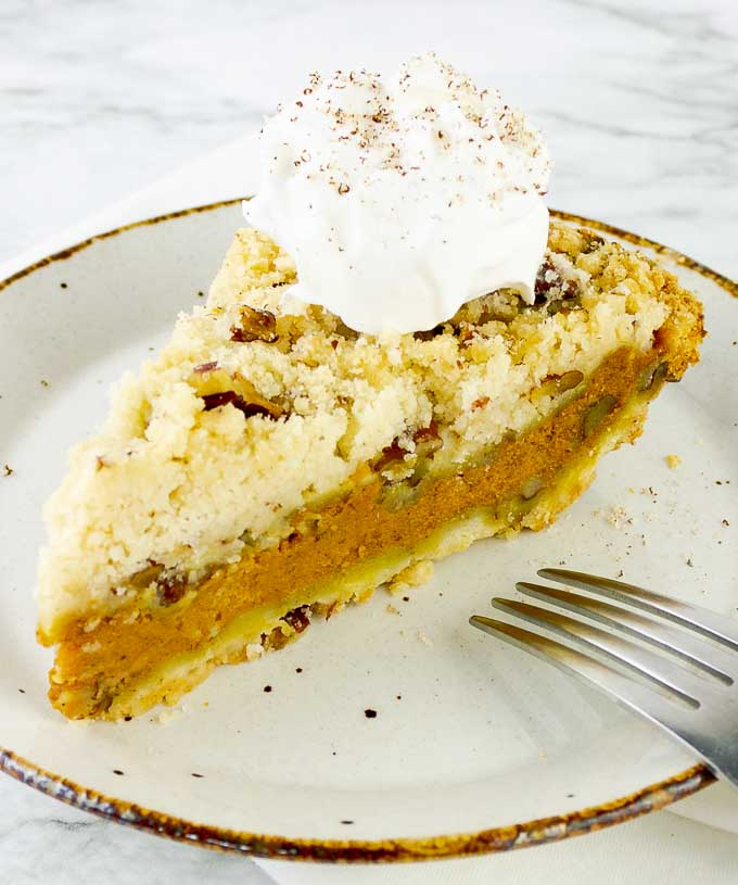 slice of Toasted Pecan Streusel Pumpkin Pie with whipped cream dollop