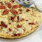 Toasted Pecan Streusel Pumpkin Pie with serving piece