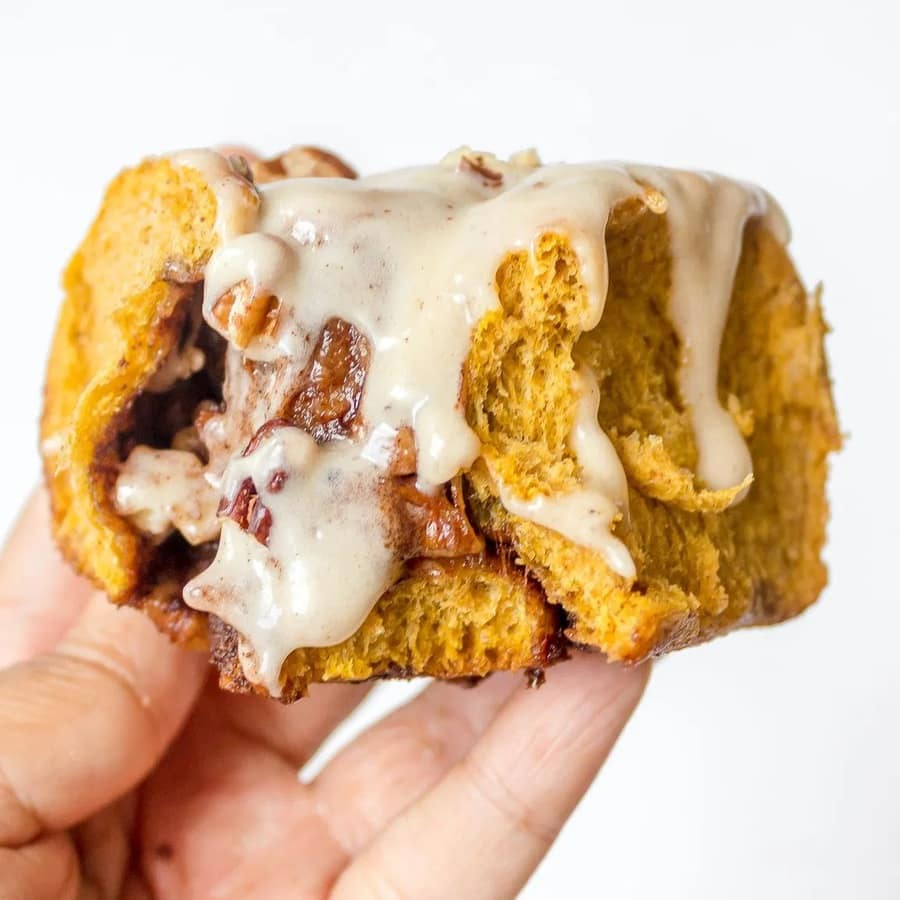 a Pumpkin Roll held up in a hand