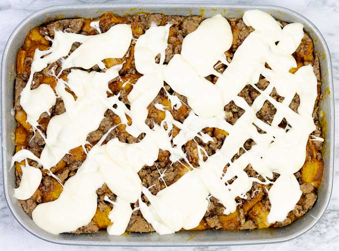 Full pan of Pumpkin bread pudding with glaze