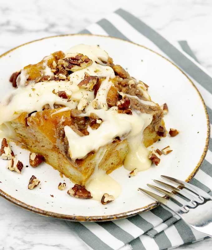 a slice of Pumpkin Pecan Custard Bread Pudding on a white plate