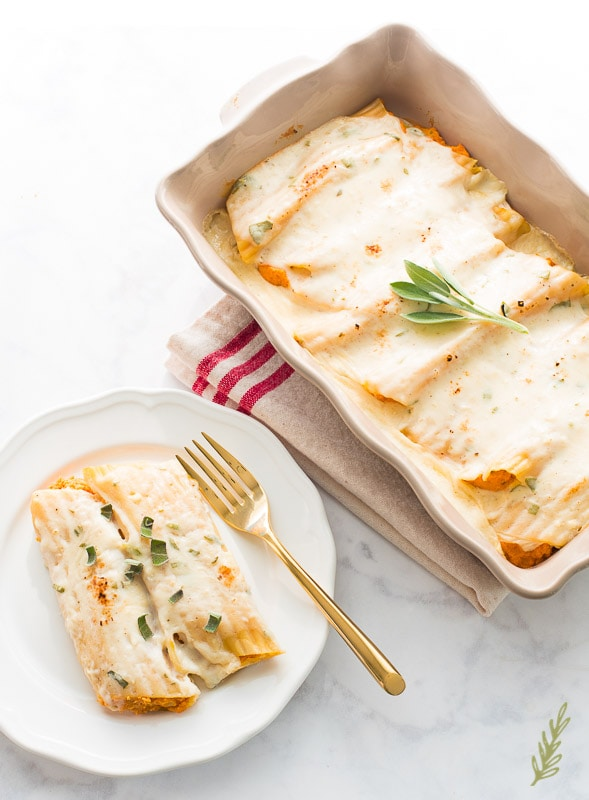 pan of Pumpkin-Stuffed-Manicotti-in-Sage-Bechamel-and a plate