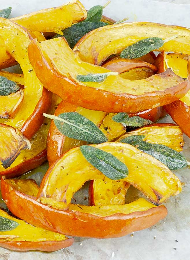 pieces of roasted pumpkin with brown buttter and sage leaves