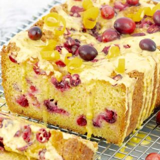 Orange Cranberry Pound Cake sliced open with drizzling glaze