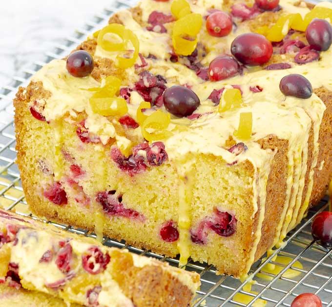 Orange Cranberry Pound Cake sliced open with drizzling glaze