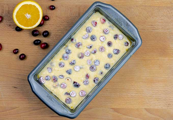 uncooked batter dotted with cranberries ready for the oven