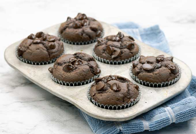 six double chocolate muffins in a metal muffin tin