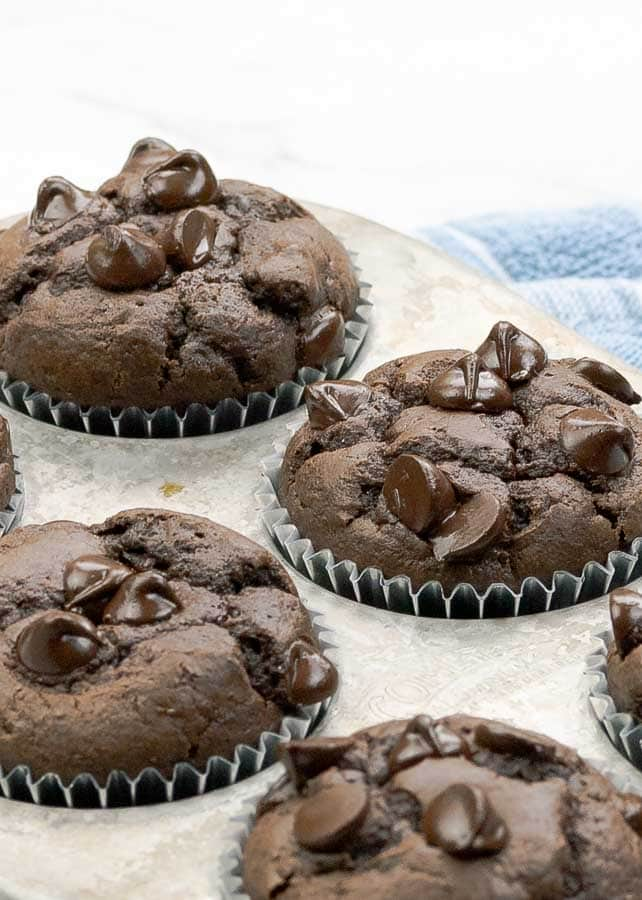 four double chocolate banana muffins shown up close