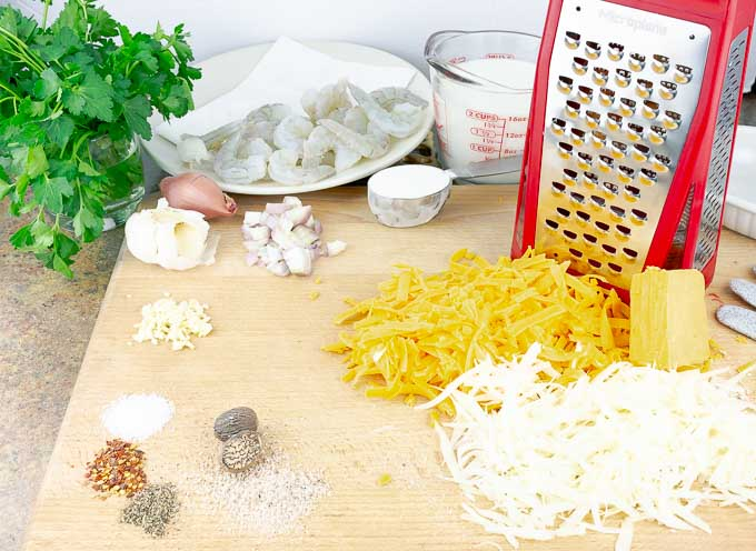 ingredients for Baked Shrimp Macaroni and Cheese on a wooden board