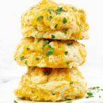 three Italian Herb Garlic Cheddar Biscuits From Scratch stacked on top of each other