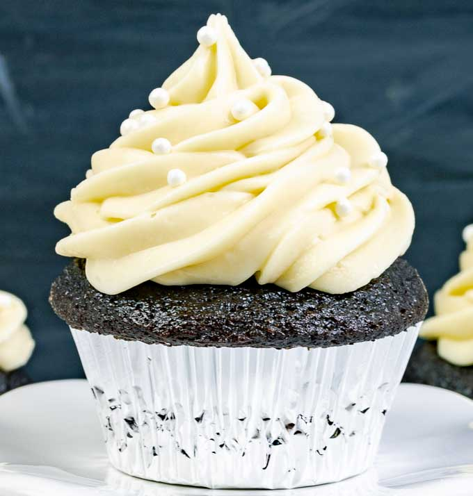 close up of a Guinness Dark Chocolate Cupcake with Irish Cream Cream Cheese Frosting in a silver wrapper