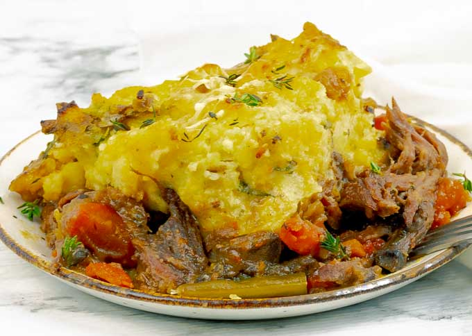 close up of a white plate of Shredded Beef Dutch Oven Shepherd's Pie