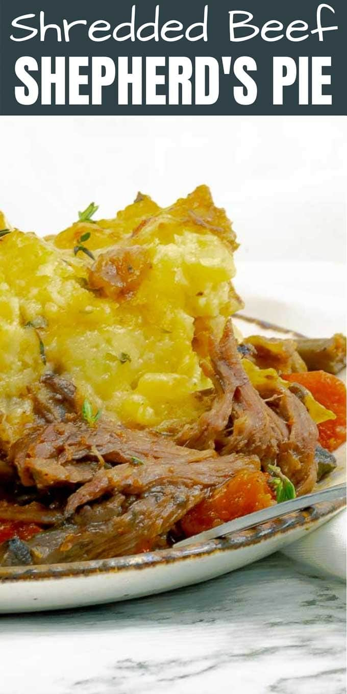 Close up of shredded beef dutch oven shepherd's pie on white plate