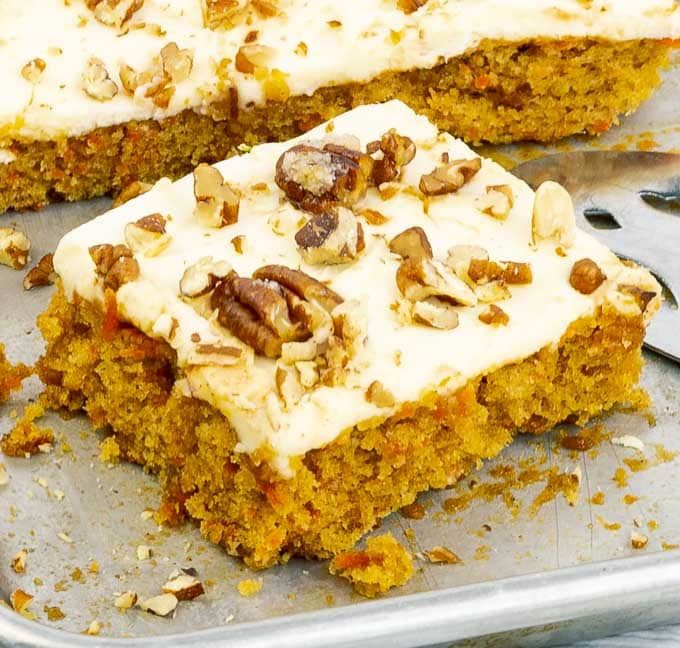 A piece of easy carrot sheet cake recipe from scratch