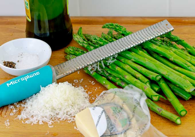 prep pictures for Easy Grilled Parmesan Asparagus on a wooden cutting board