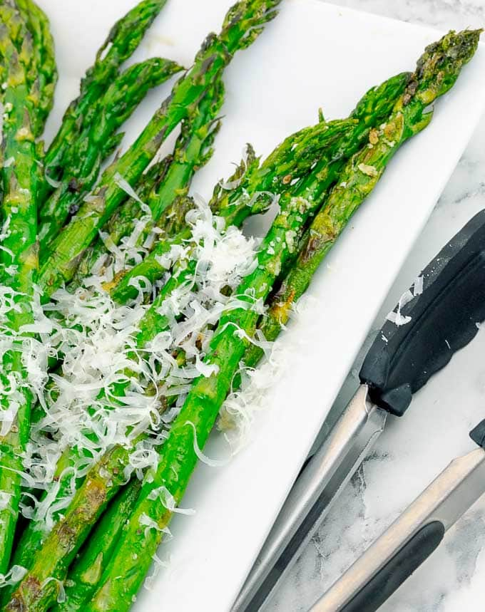 Easy Grilled Parmesan Asparagus on white plate