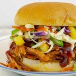 Barbecued Pulled Pork on a sandwich with pineapple slaw