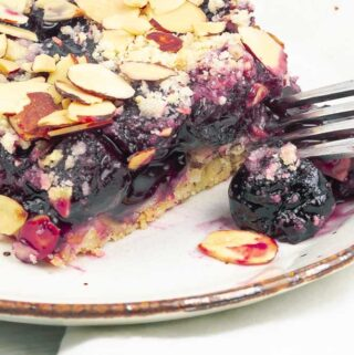 close up of a cherry almond pie bar