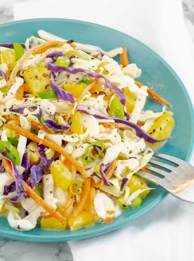 Easy Fresh Pineapple Slaw on a blue plate with fork