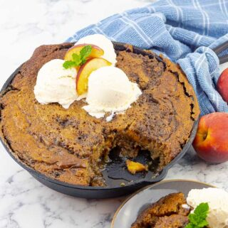 grilled fresh peach cast iron skillet cake and a plate of the cake with ice cream