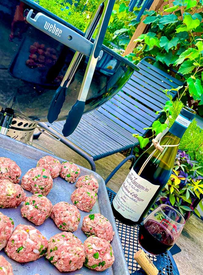 raw Italian homemade meatballs ready to be gilled
