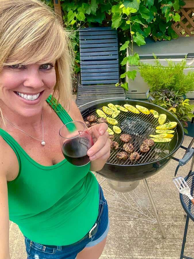 Jennifer in front of a grill making Italian meatballs