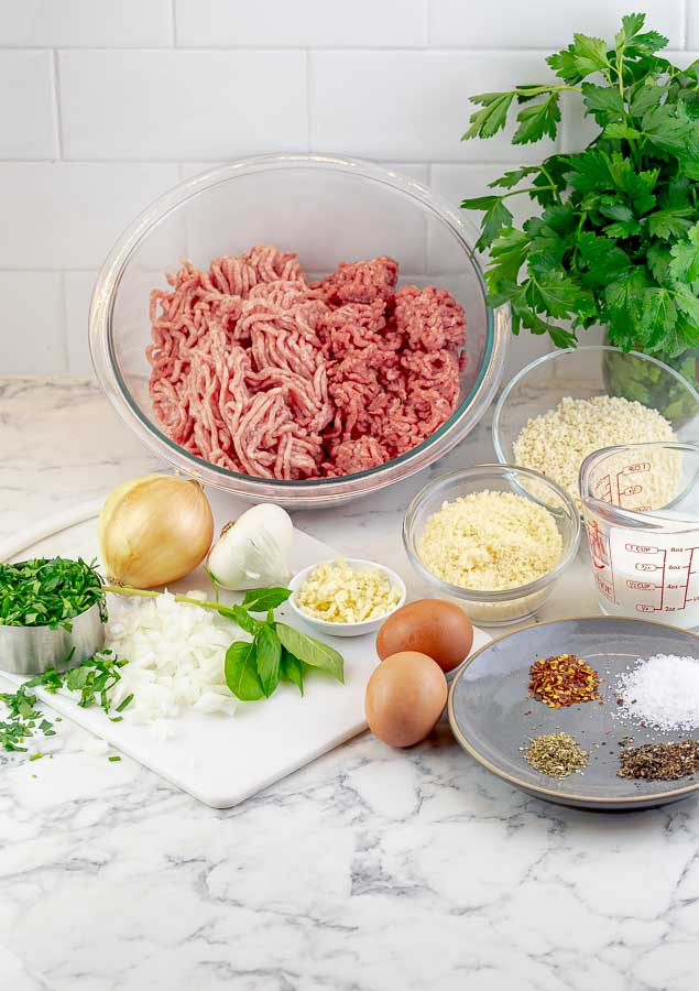 ingredients being prepped for grilled Italian meatballs