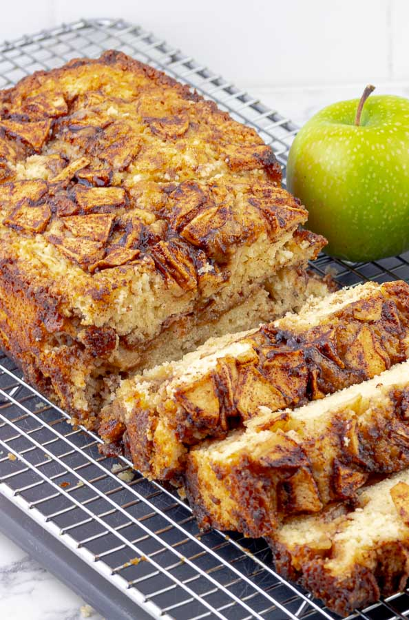 Apple Cinnamon Swirl Loaf on wire rack with 3 slices cut