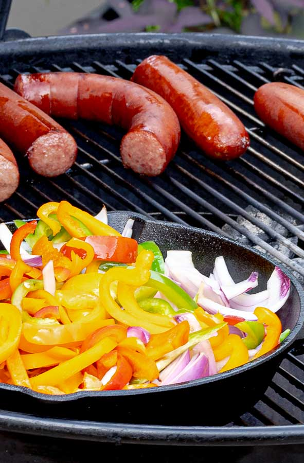 Grilled Sausage with Peppers and Onions on a barbecue grill