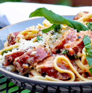 gray plate of grilled salsiccia pasta